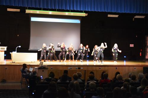 Teachers dance to 1960s music