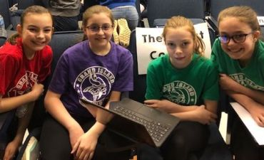 Four students compete in battle of the books