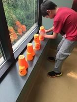 Student trying cup exercise