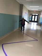 Student zig zagging down hall