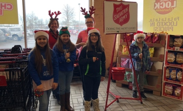 Students ring the Salvation Army bell at Tops Markets