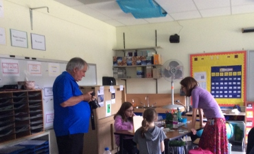 Dr. Kagan observes students at work
