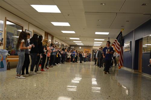 Veterans parade through hallways