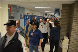 Veterans walk at the indoor parade