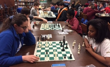 Middle School chess club students practice their game