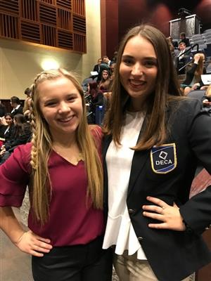 Two students at DECA
