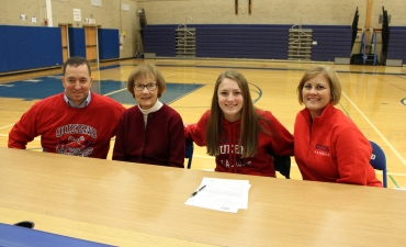 Rosie and her family sign her letter of intent