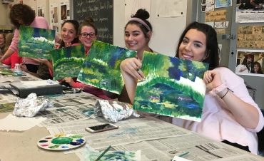 Students with Monet inspired paintings