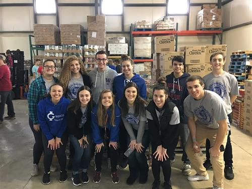 Honor Society students pack food bags
